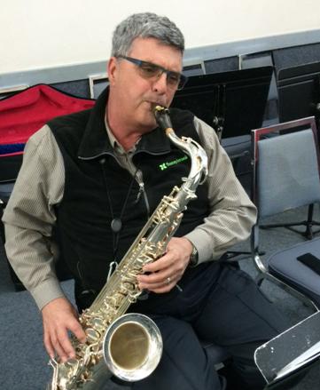 David Hutzel playing sax at New Ventures Band